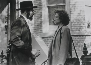 Still from A Stranger Among Us, starring Melanie Griffith and Eric Thal. The film was written and produced by Robert J. Avrech and directed by Sidney Lumet.