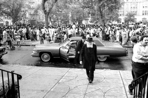 Neighbors stop to watch the Rebbe arrive at 770 Eastern Parkway, circa summer 1977.