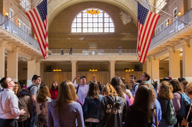 Experienced tour guide and Yeshiva University Alumnus Yitzchak Schwartz walks students through the footsteps of their grandparents in the inspection halls of Ellis Island as part of YU's Family Discovery Club's first event. The Family Discovery Club is a club for students at YU interested in researching their personal family histories. Photo: David Kabinsky/Yeshiva University