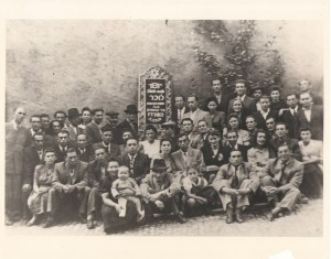 Sieradz survivors in a DP camp in Landsberg, Germany, circa 1946-47. Note the memorial plaque in the background dedicated to those murdered in the Polish town of Sieradz. Seated second row, fourth from the left, is the author's uncle, David Leibish Jakubowicz; his younger brother Michoel, the author's father, is seated, same row, second from the right. Next to Michoel, third from the right, is his wife, Mala (Malka), the author's mother. Photos courtesy of Bayla Sheva Brenner, unless indicated otherwise.