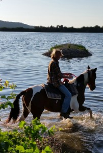 A central part of the treatment at Retorno Jewish International Rehabilitation Center is therapeutic horseback riding, which connects the rider not only to the horse but to himself and his emotions. Seen here, clients trotting through a nearby pond during an afternoon horseback riding activity. Courtesy of Rabbi Eitan Eckstein