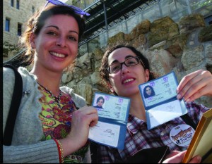 Two French olim proudly showing their new Israeli ID cards.  Photos courtesy of the Jewish Agency for Israel