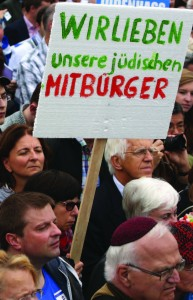 "A demonstrator holds a sign reading ""We Love Our Jewish Fellow Citizens"" in German during a rally against anti-Semitism on September 14, 2014, in Berlin, Germany. With the slogan ""Stand Up! Never Again Hatred Towards Jews"" (""Steh auf! Nie wieder Judenhass""), the Central Council of Jews in Germany (Zentralrat der Juden) organized the demonstration after anti-Semitic incidents in the country occurred in the wake of the conflict in Gaza that summer.  Photo: Adam Berry/Getty Images"