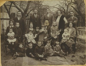 The Kurzweil family in Dobromil, Poland (ca. 1925). Fourteen out of the twenty-one people in the photo were murdered during the Holocaust. Arthur Kurzweil's great-grandfather, Avraham Abisch Kurzweil, is in the center; Arthur's father, Chaim Shaul (Saul) Kurzweil is sitting on the ground, second from right. Photo courtesy of Arthur Kurzweil