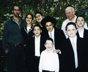 Rav Lichtenstein outside his home in Yerushalayim with some of his children and grandchildren. Courtesy of Yechiel Lichtenstein