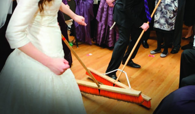 """In the """"mizinke,"""" otherwise known as the """"broom dance,"""" the parents of the bride or groom sit together, while family and friends form a circle and dance around them to the tune of an upbeat Klezmer melody, """"Di Mizinke Oysgegebn, The Youngest Daughter is Given Away.""""  Photo: Yehuda Boltshauser/Kuvien"""