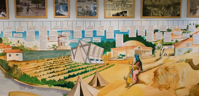 A large panel artistically depicts the 4,000-year history of Jews in Gush Katif.