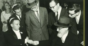 The author's wedding on November 1, 1959, in New York. Seated, on the left, is the author; in the center, standing, is Rav Aharon Lichtenstein, witness to the ketubah; seated on the right is Rav Joseph B. Soloveitchik, mesader Kiddushin and rebbe of the author. Courtesy of Julius Berman