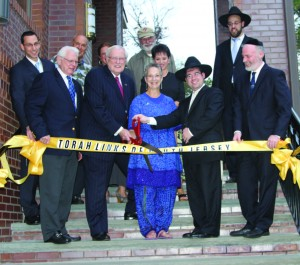 Ribbon-cutting ceremony at the Max and Anna Krupnick Torah Links Center. Second from the right, in the front row, is Rabbi Yisroel Tzvi Serebrowski, founding rabbi and director, Torah Links of South Jersey. Photo courtesy of Rabbi Serebrowski