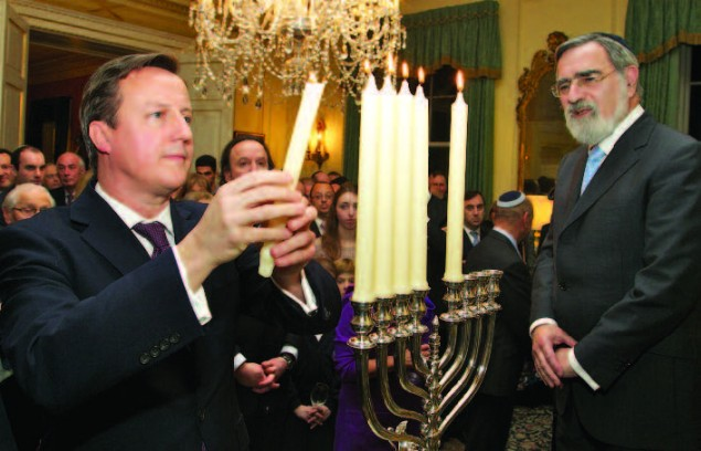 Chief Rabbi Lord Jonathan Sacks joining Prime Minister Cameron for the lighting of the Chanukah lights in Downing Street. Photo: Nicola Hammer